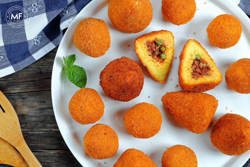 Crispy, golden arancini - Sicilian saffron-infused rice balls stuffed with a meat sauce.