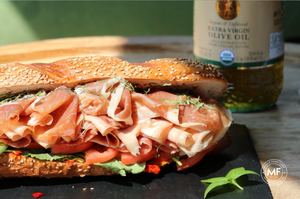 A delicious Sicilian inspired sandwich packed with prosciutto, Mortadella, spicy Calabrian Chili Peppers.